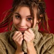 Stock Photo: Beautiful young womwith dreadlocks on red background