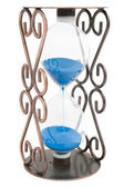 Hourglass with blue sand in a metal frame isolated — Stockfoto