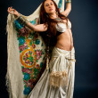 Attractive retro model in old-fashioned wild clothing dancing — Stock Photo