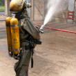 Stock Photo: Firefighters in chemical protection suit