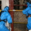 Man in chemical suit — Stock Photo #27259593