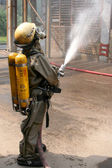 Firefighters in chemical protection suit — Stock Photo