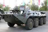 Old Soviet Armored troop-carrier on the street — Stok fotoğraf