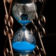 Hourglass with blue sand — Stock Photo #38860461
