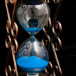 Hourglass with blue sand — Stock Photo