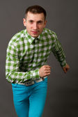Young guy in a checkered shirt — Stock Photo