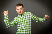 Guy in a checkered shirt — Stock Photo