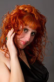 red-haired girl in a black dress — Foto Stock