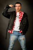 Young man in a leather jacket  — Stock Photo