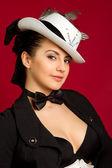 Brunette girl in a white hat — Stock Photo
