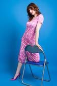 Morena com um vestido rosa — Fotografia Stock