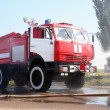 The fire truck extinguishes the lit-up plane — Stock Photo #50981117