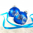 Christmas blue baubles and ribbon on snow — Stock Photo