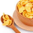 Cornflakes in bowl and spoon — Stock Photo