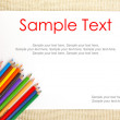 Paper on burlap with pencils & text — Stock Photo
