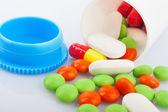 Pills in plastic jar — Stock Photo