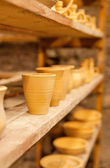 Pottery dishes on shelves — Photo
