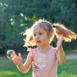 Little girl with bubbles — Stock Photo #47448251