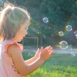 Little girl with bubbles — Stock Photo #47448317