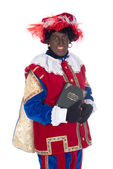 Zwarte Piet with his book — Stock Photo