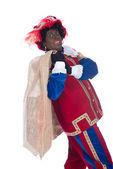 Zwarte Piet mit einem Sack voll Geschenke — Stockfoto