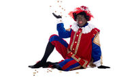 Zwarte Piet is throwing ginger nuts — Stock Photo