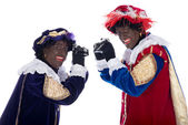 Zwarte Piet and his co-worker are taking photographs — Stock Photo