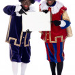 Zwarte Piet with a whiteboard, to put your own text on — Stock Photo