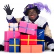 Zwarte Piet with a lot of presents — Stock Photo
