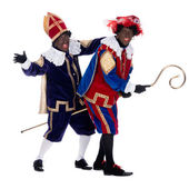 Zwarte Piet and the staff of Sinterklaas — Stock Photo