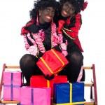 Portrait of Zwarte Piet with presents — Stock Photo