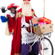 Sinterklaas and Black Pete on bike — Stock Photo #34884727