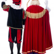 Sinterklaas and Black Pete from back — Stock Photo #34886337