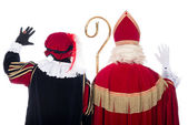 Sinterklaas and Black Pete from the back — Zdjęcie stockowe