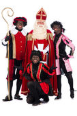 Sinterklaas and a couple of his helpers — Stock Photo