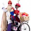 Sinterklaas and Black Pete on bike — Stock Photo #34917067