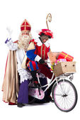Sinterklaas and Black Pete on a bike — Stock Photo
