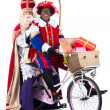 Sinterklaas and Black Pete on bike — Stock Photo #34920091