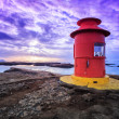 Small red lighthouse — Stock Photo #24159457