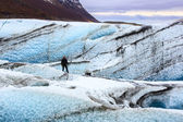 Lone man standing on a glacier — Stock Photo