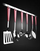 Rack of kitchen utensils — Stock Photo