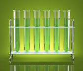 Tubes with green chemicals — Stock Photo