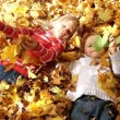 Children in the yellow leaves — Stock Video