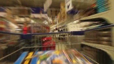 Trolley in a supermarket — Wideo stockowe