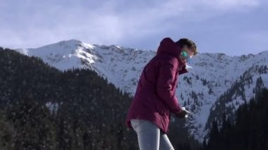 Winter Resort. Young woman throwing snowballs — Stock Video