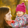 Mother and daughter in the park — Stock Photo #12503367