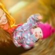 Mother and daughter playing in the park — Stock Photo