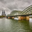 Cologne Cathedral and Hohenzollern Bridge, Germany — Stock Photo #13609925