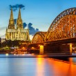 Cologne Cathedral and Hohenzollern Bridge, Germany - Stock Photo