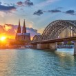 Cologne at sunset - Stock Photo